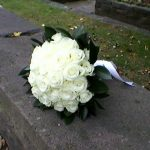 bouquet of white roses on a wall