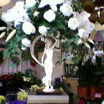 Statue holding a bouquet of flowers