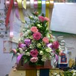 pink and yellow flowers in a basket