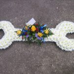 white flowers arranged in the shape of a wrench