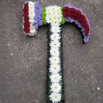 An assortment of flowers in the shape of a hammer