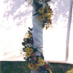 flowers wrapped around a pillar