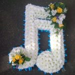 White flowers arranged in a musical shape