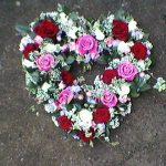 Pink and red roses in a heart.