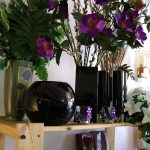 a selection of vases and flowers in the shop