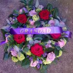 wreath with a ribbon that reads 'grandad'.