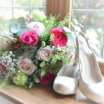 bouquet of flowers next to a pair of high heels