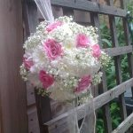 bouquet hanging on a wooden fence