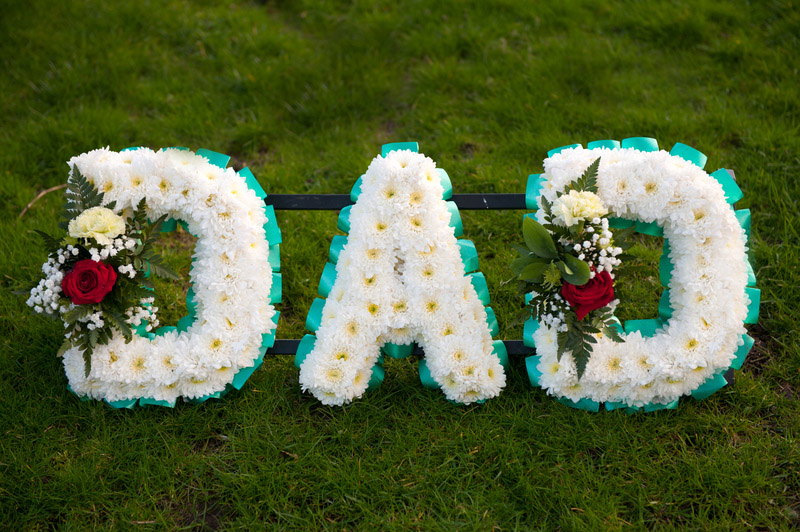 Flowers spelling out 'Dad'