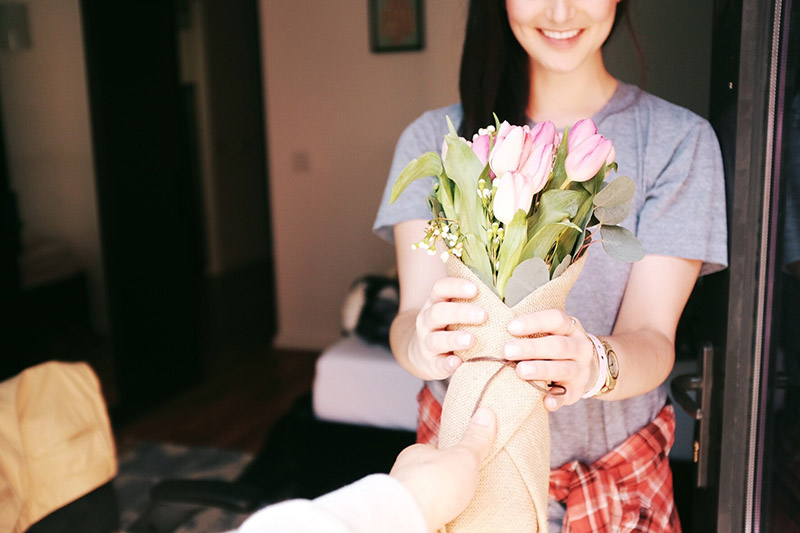 girl receiving flowers