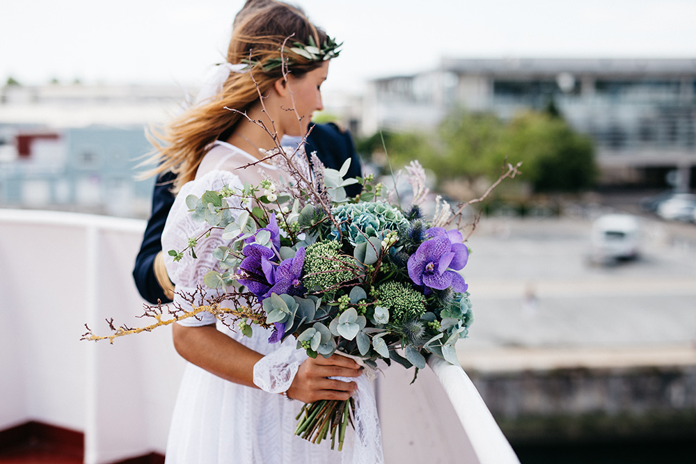 Bride with a purple wedding bouquet