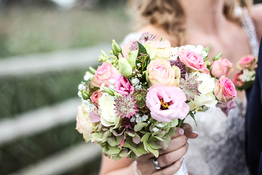 bride holding on to the Wedding bouquet